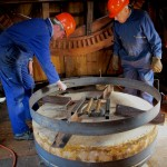 Douglas Andrews, Wheelwright, checking steel band for correct fit prior to heating.
